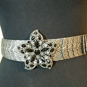 Distressed silver colored belt w/ flower buckle